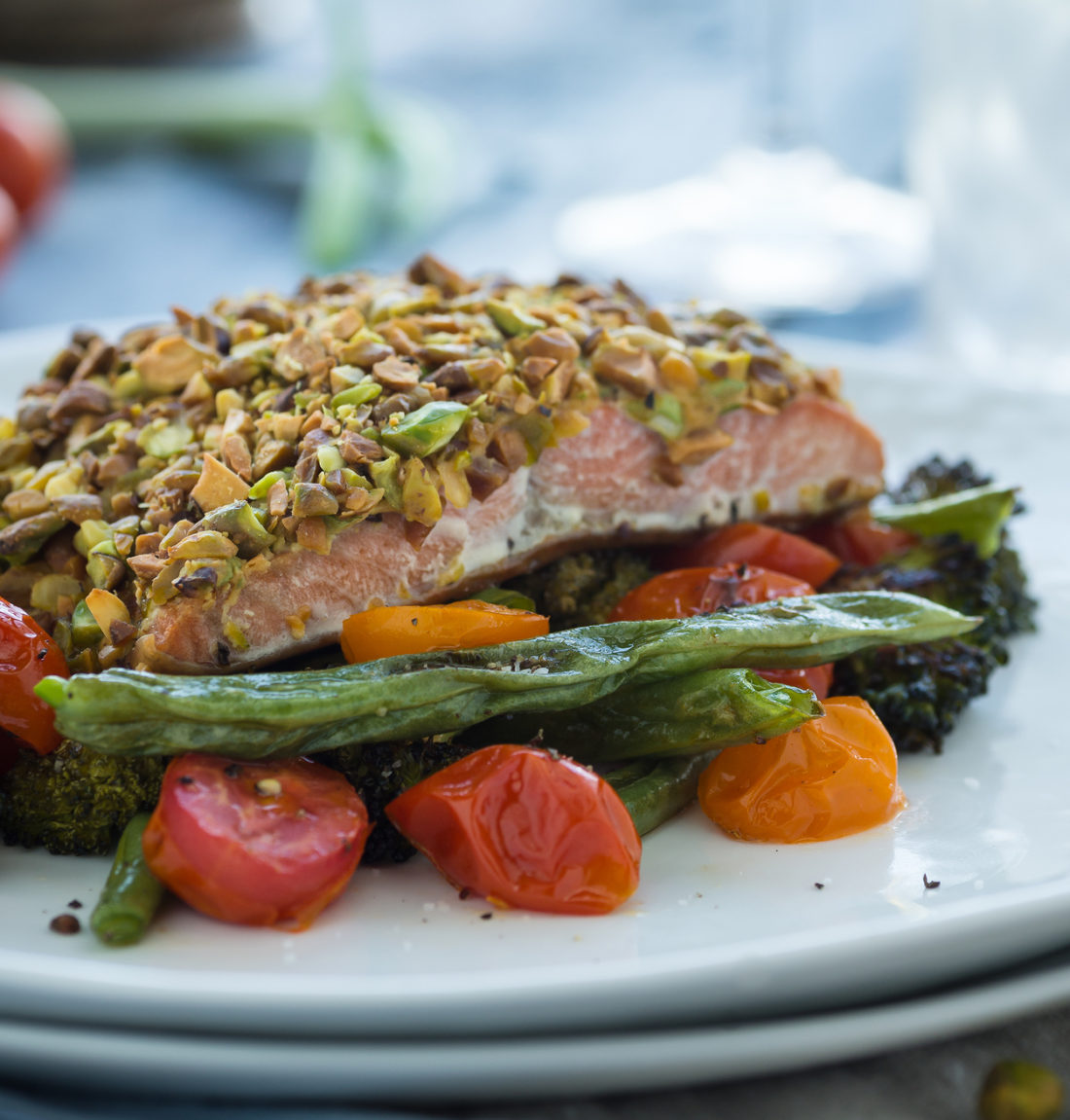 Roasted vegetables with baked pistachio wasabi crusted salmon ** Note: Shallow depth of field